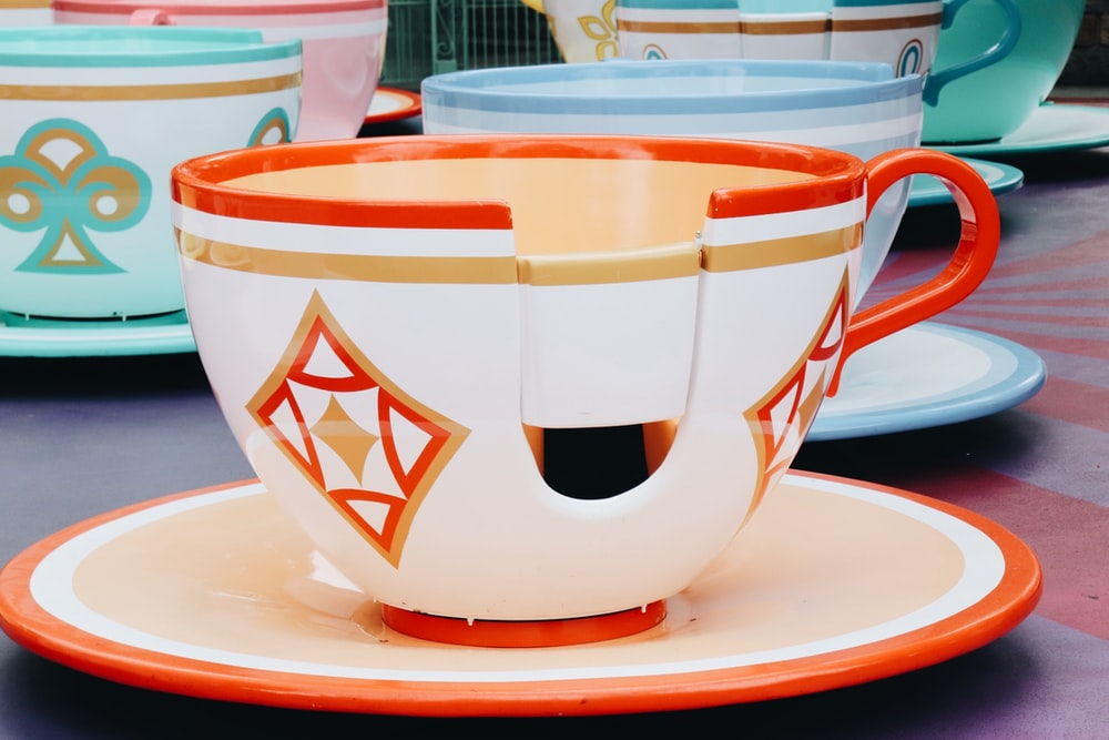 white and red ceramic teacup on saucer