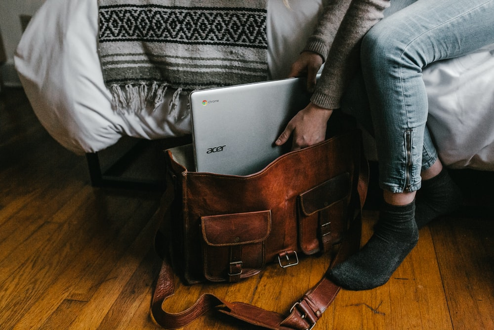 person holding silver Acer Chromebook laptop
