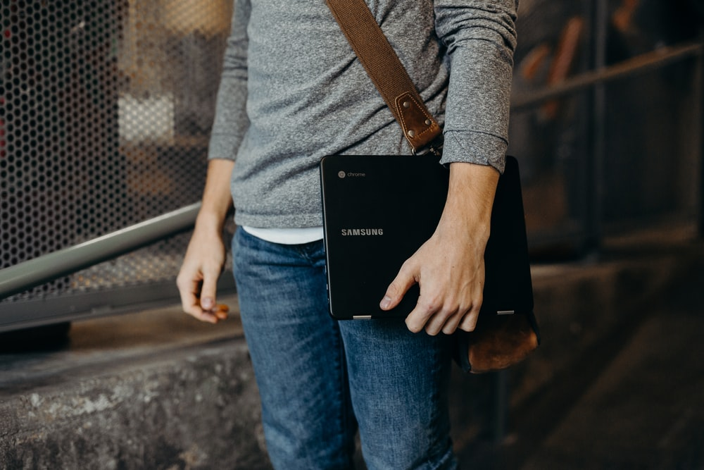 person holding black laptop computer