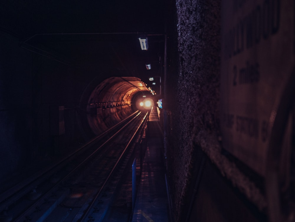 gray concrete tunnel with narrow pathway