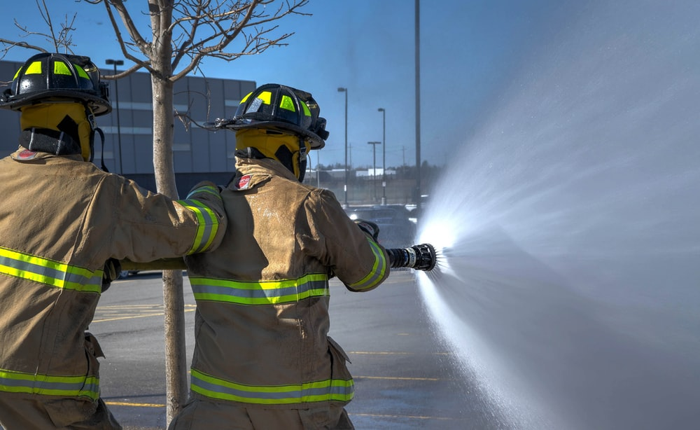 time lapse photography of two firemen
