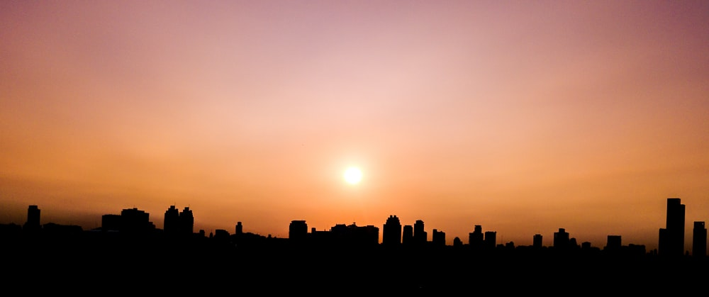 silhouette photography of building during sunset