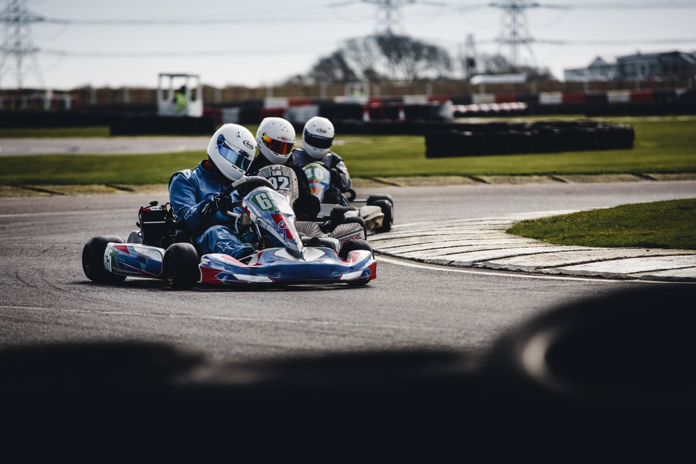 three person racing in go-kart