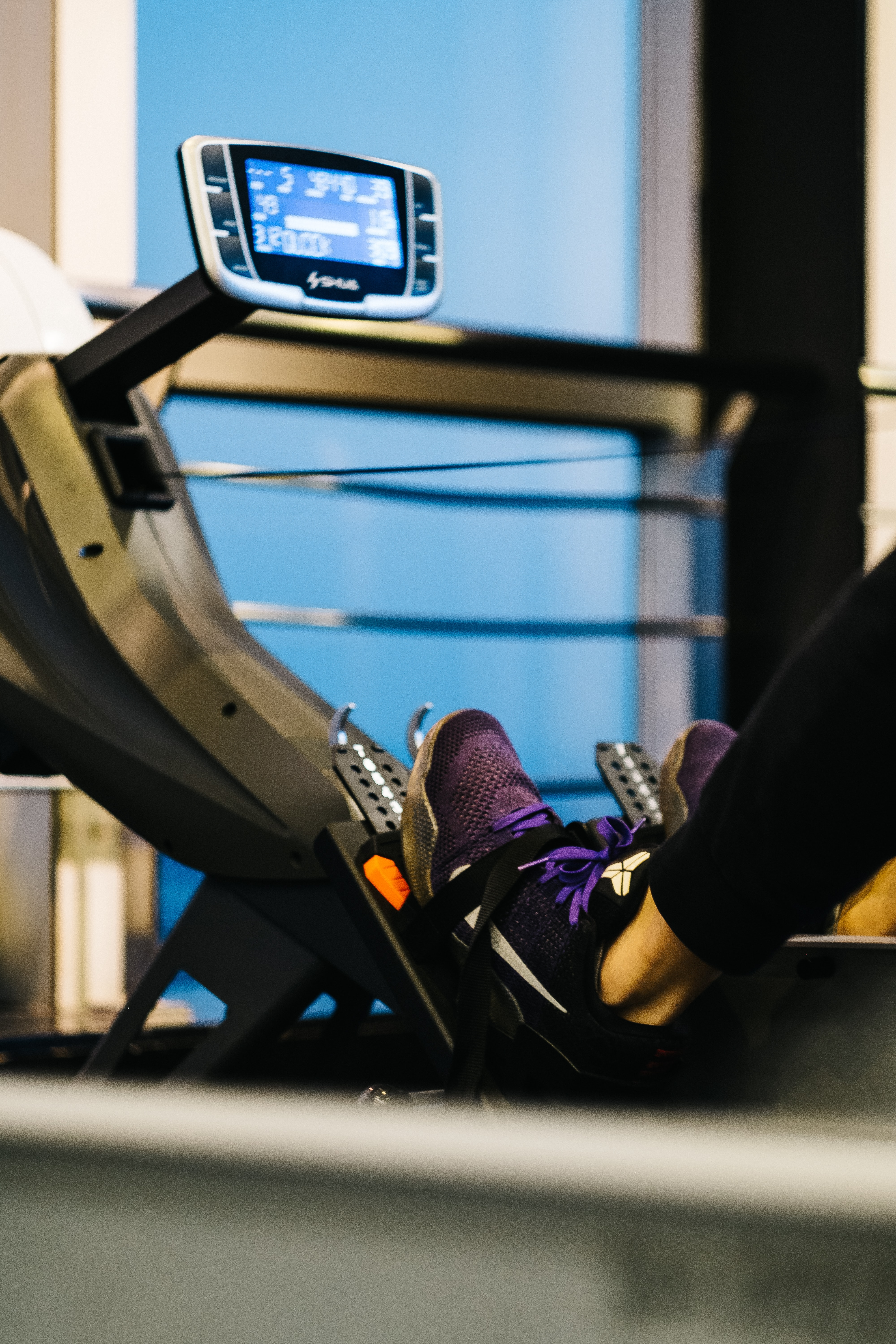 person on gym equipment exercising