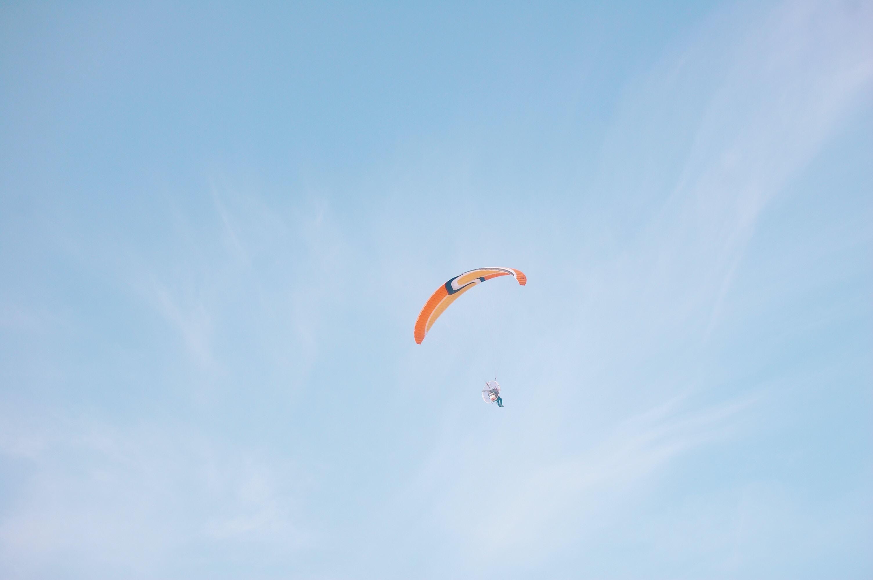 person parachuting during daytime
