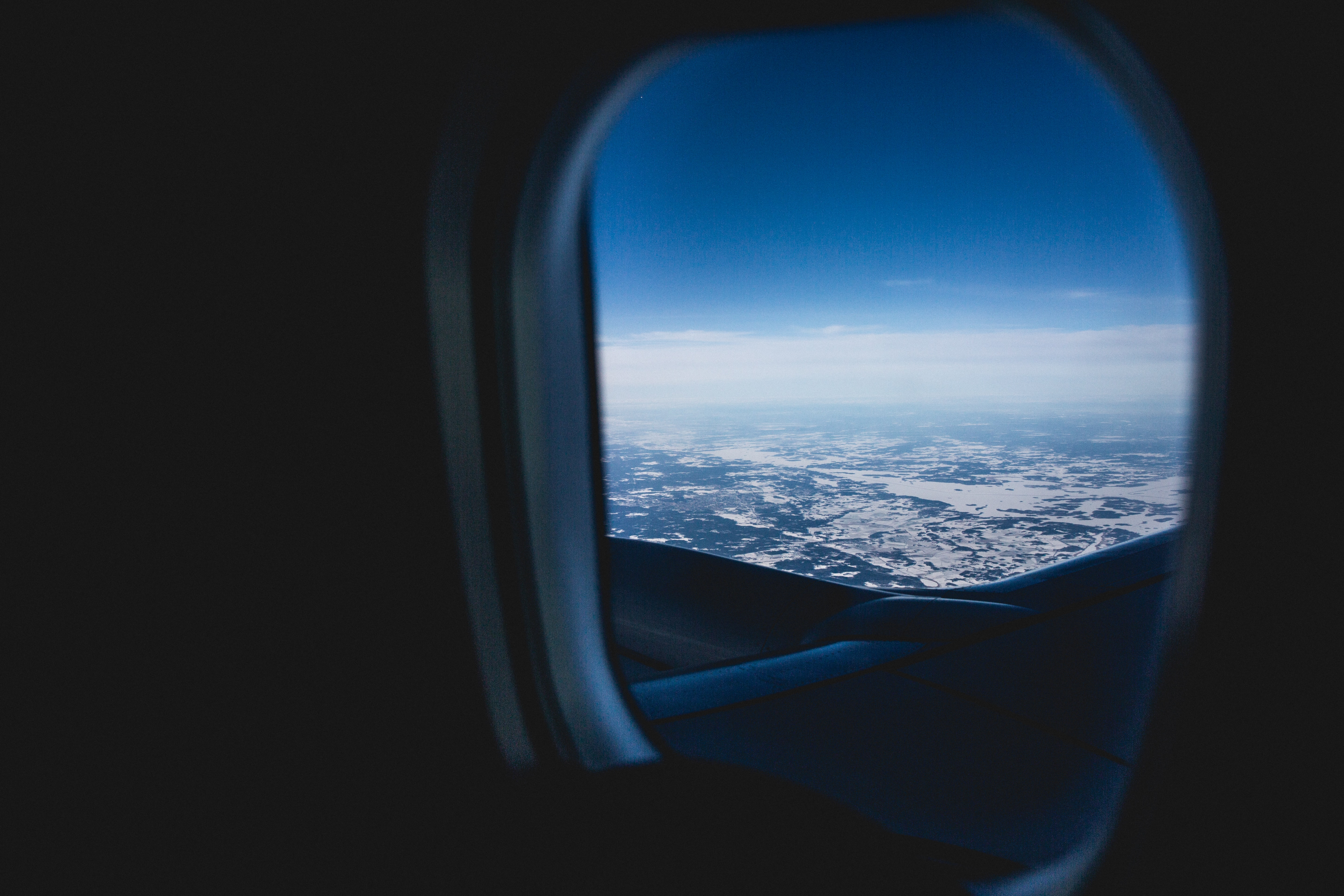 selective focus photography of airplane window