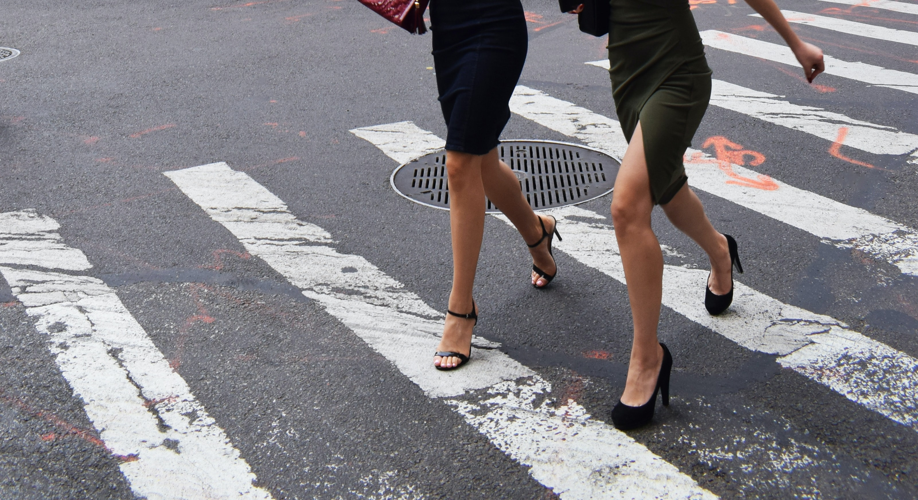 two women walking on pedestrian lane