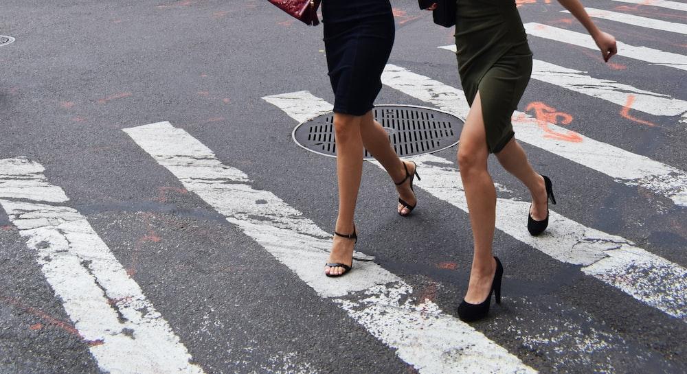 two women walking on pedestrian lane