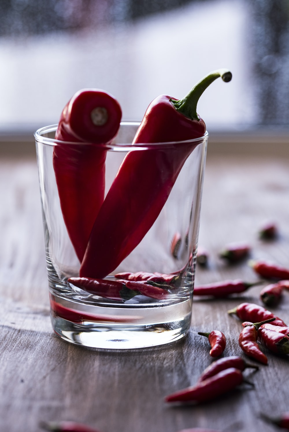 two red chilies in clear shot glass