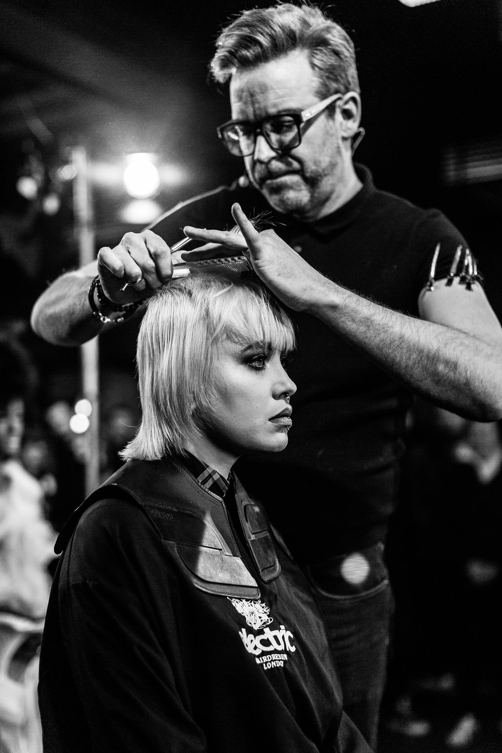 Sway Bar, London, United Kingdom. Hairdresser at work