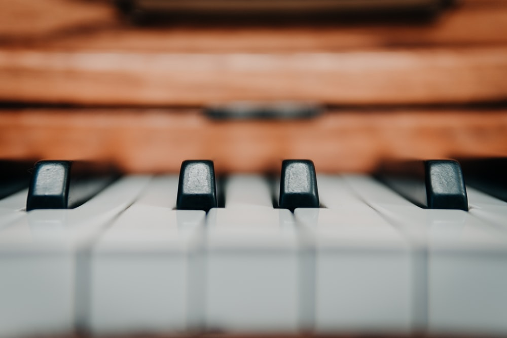selective focus photography of piano keys