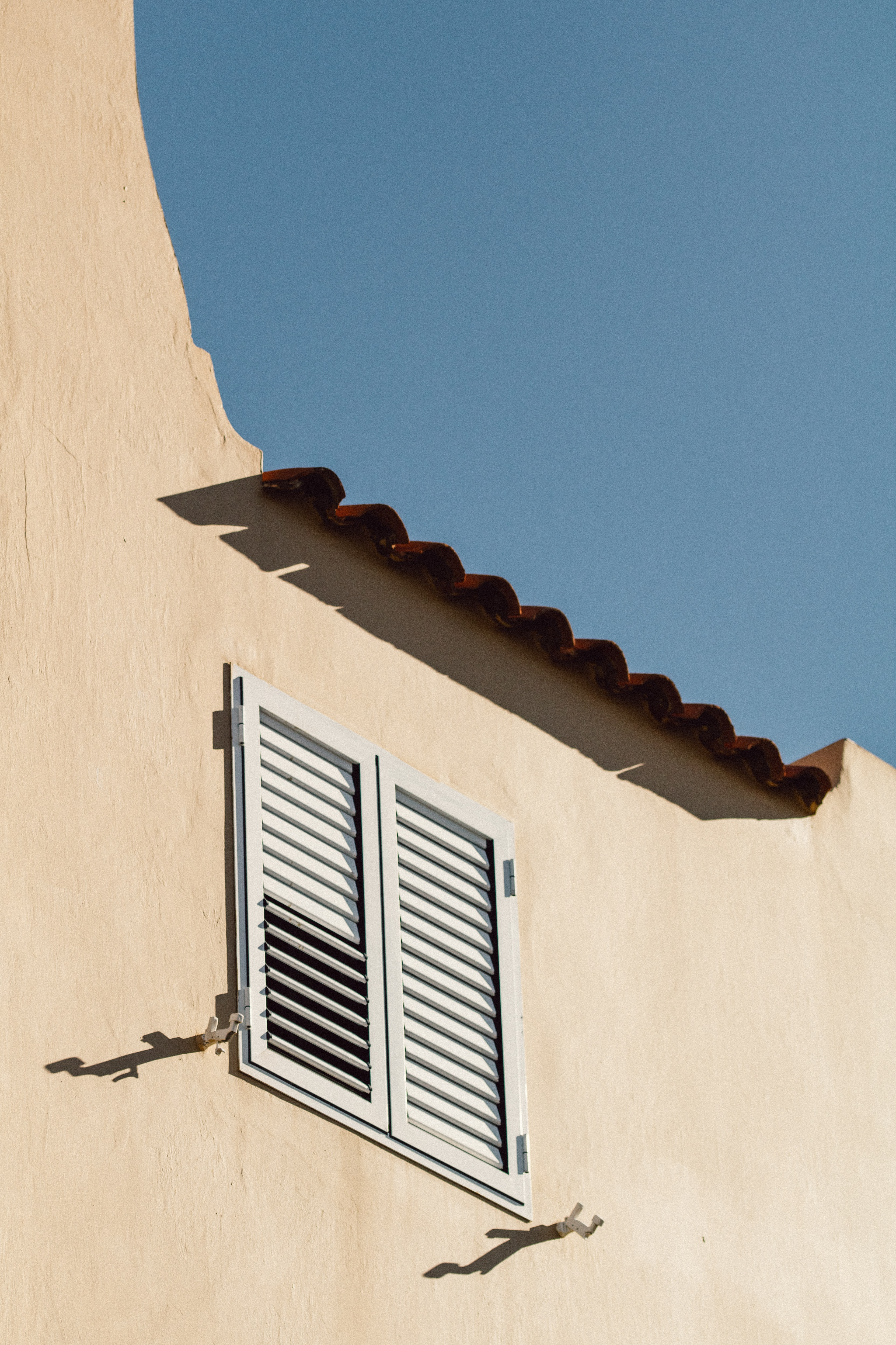 closed white louvered windows