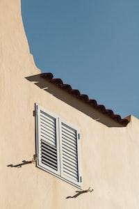 closed white louvered windows