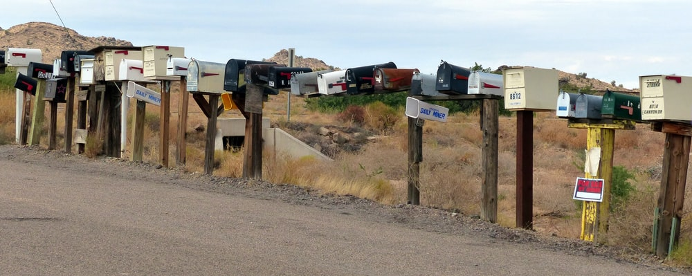 assorted-color mail bot lot on gray concrete road