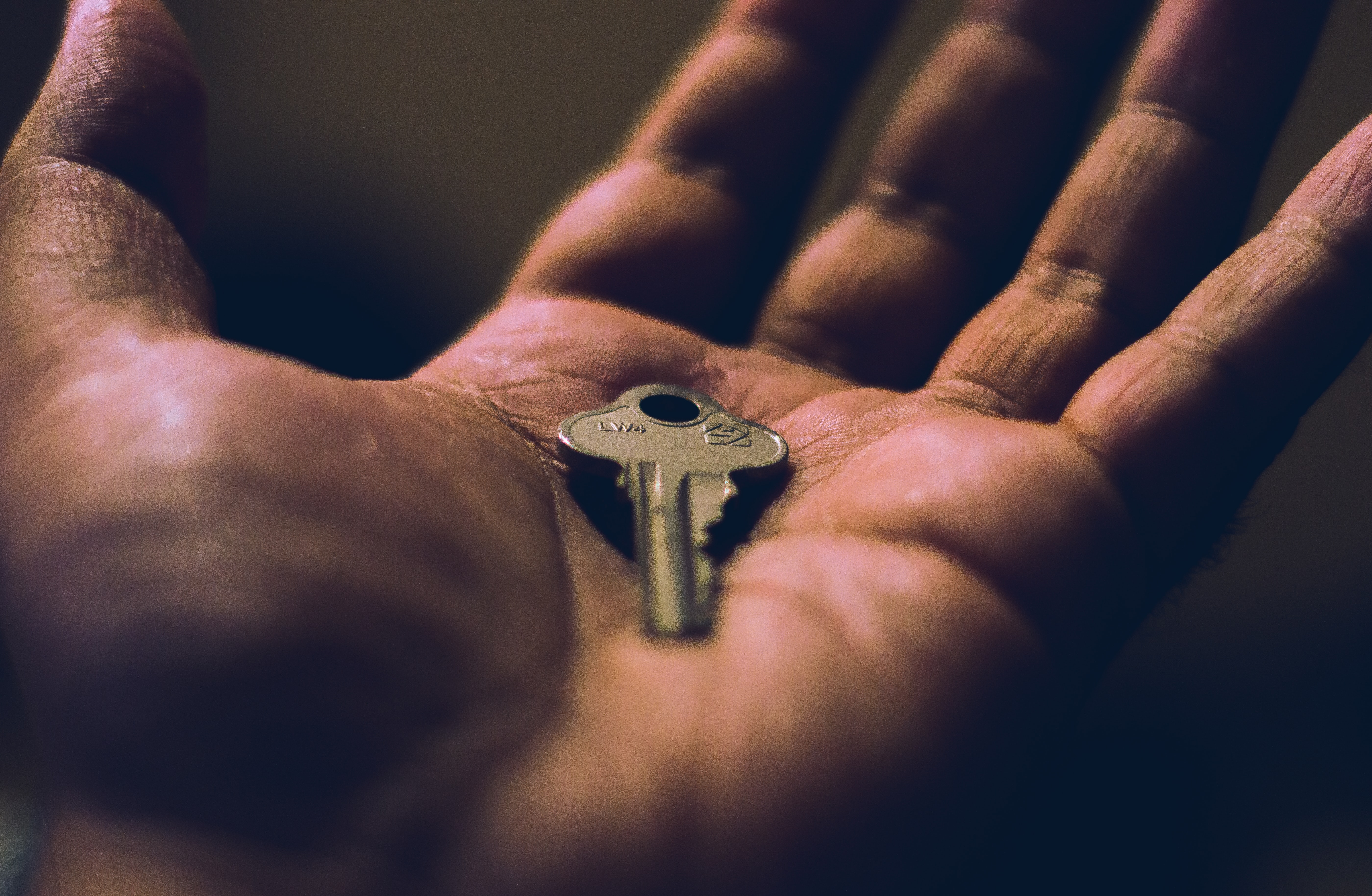 person holding key