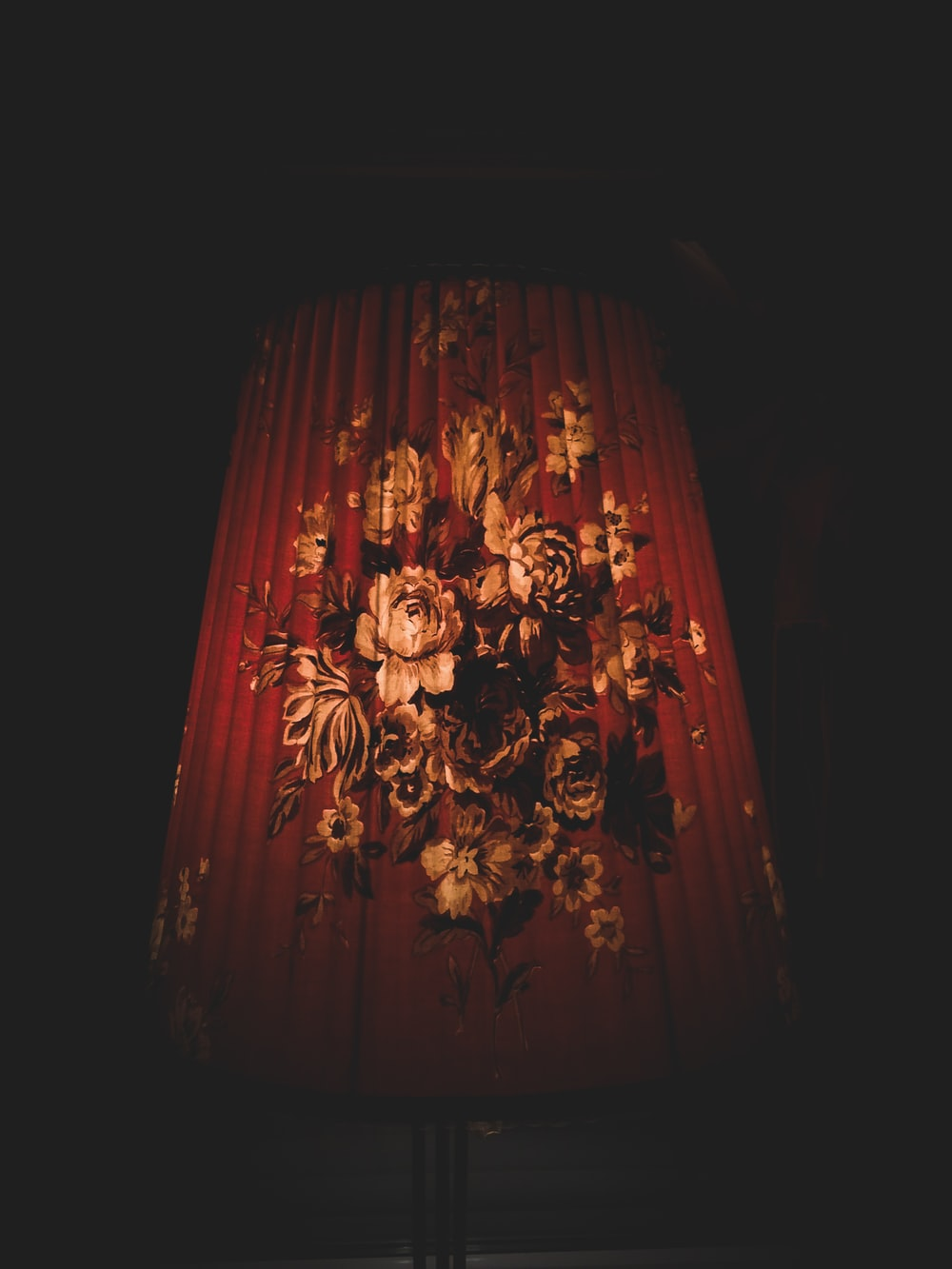 closeup photo of red and brown floral lampshade