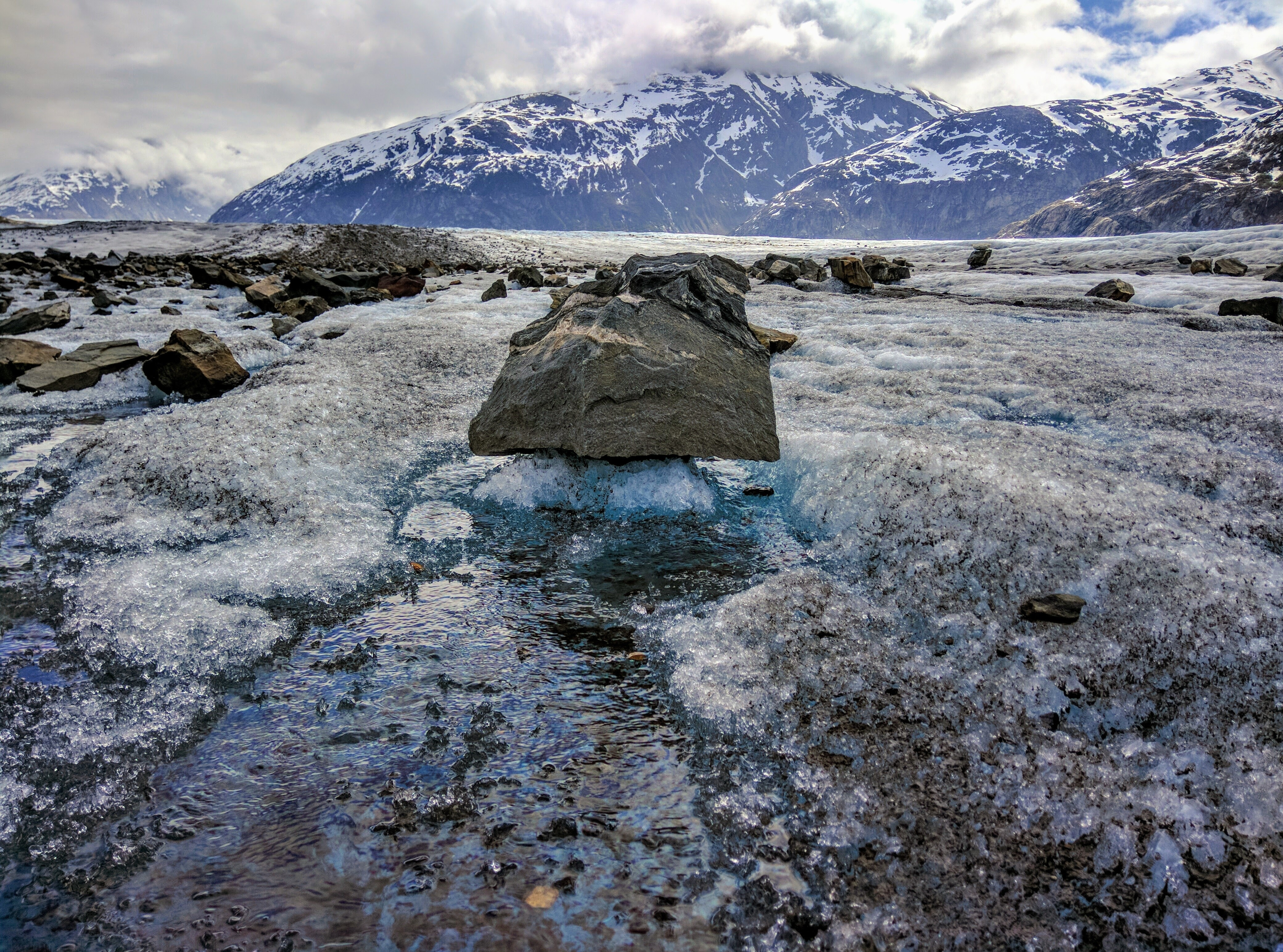 gray rock in body of water at daytime