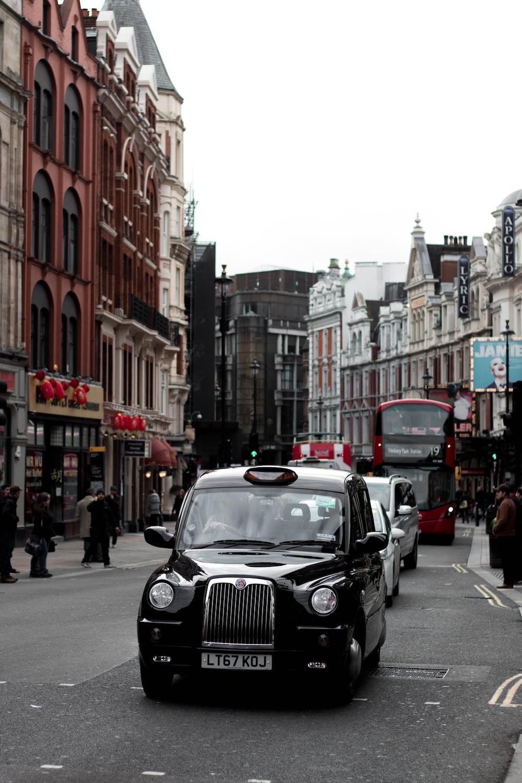 black cab on road during daytime