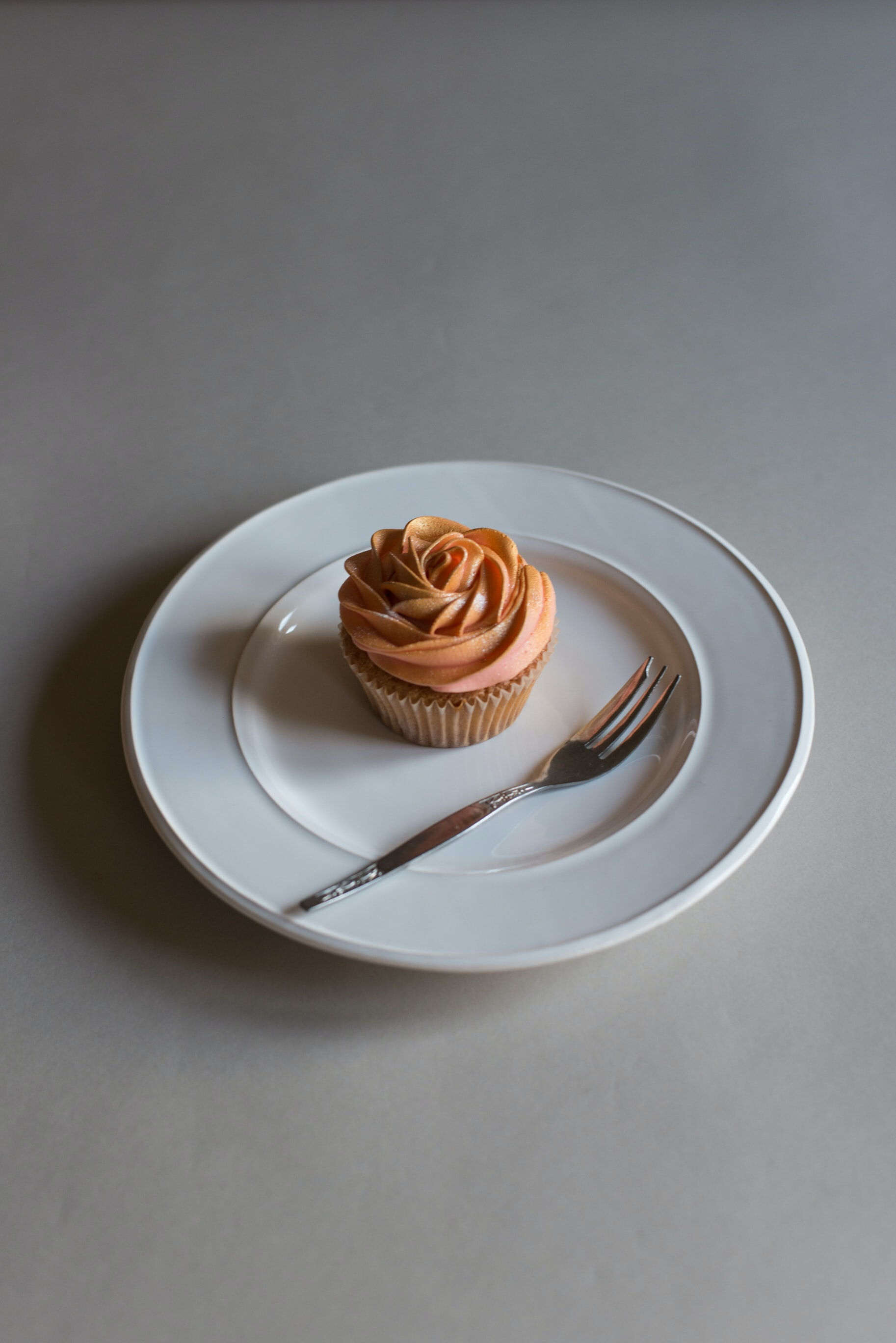 round ceramic plate with cupcake on top