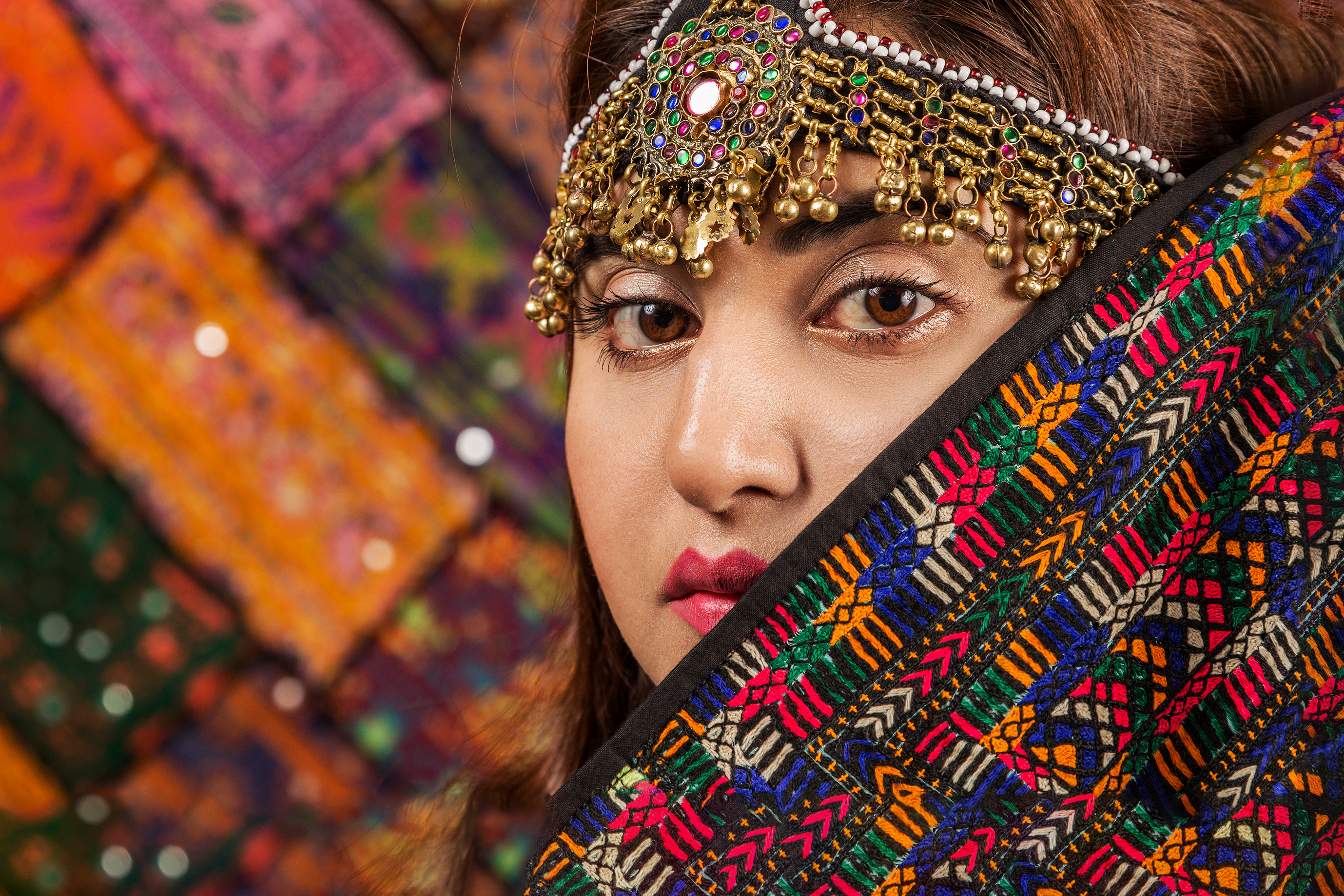 Woman Covered By Multicolored Scarf