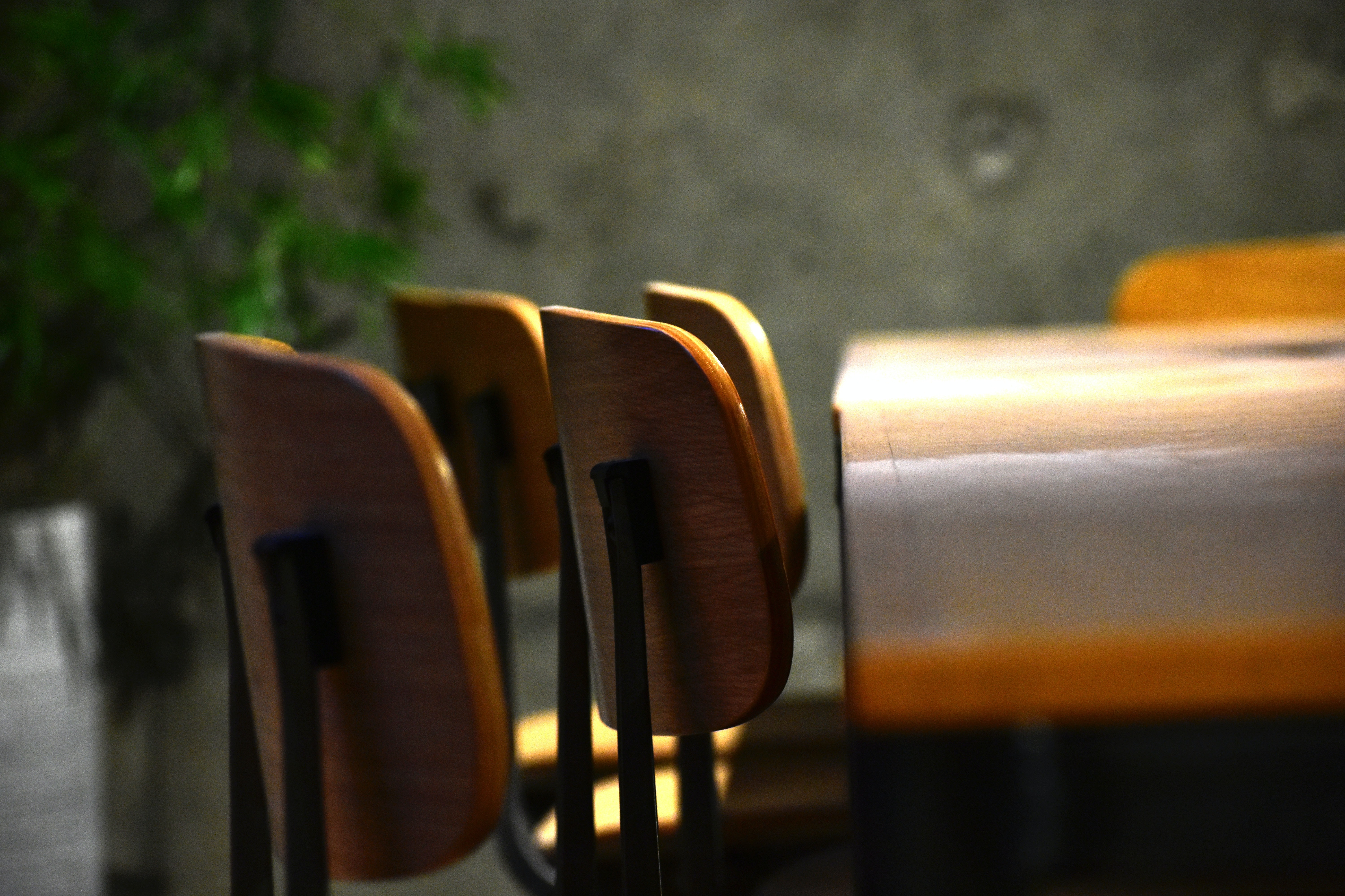 four brown and black chairs