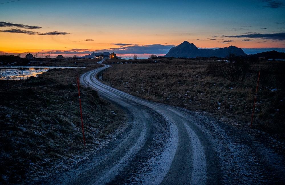 landscape of road beside ocean