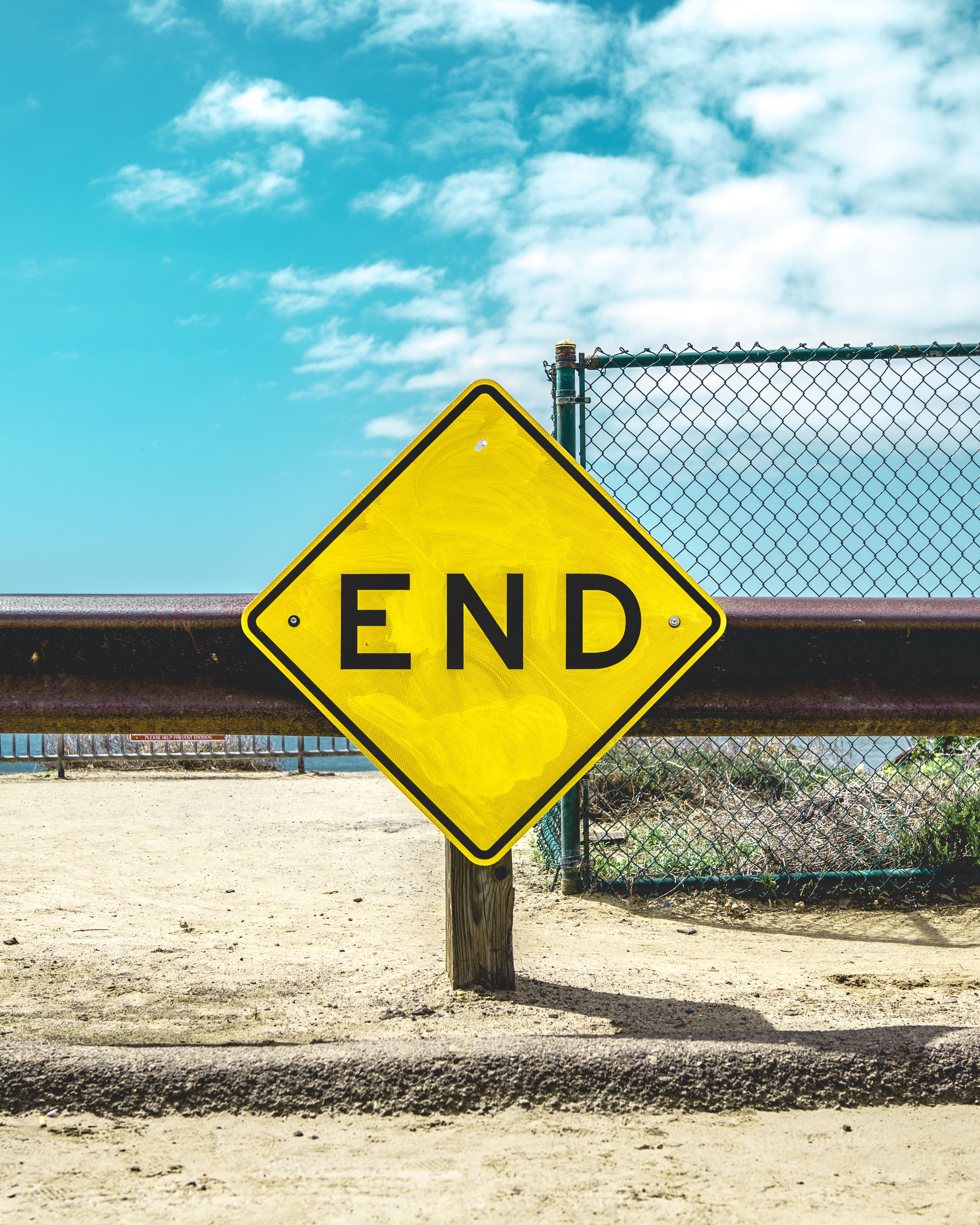 End sign on beige sand