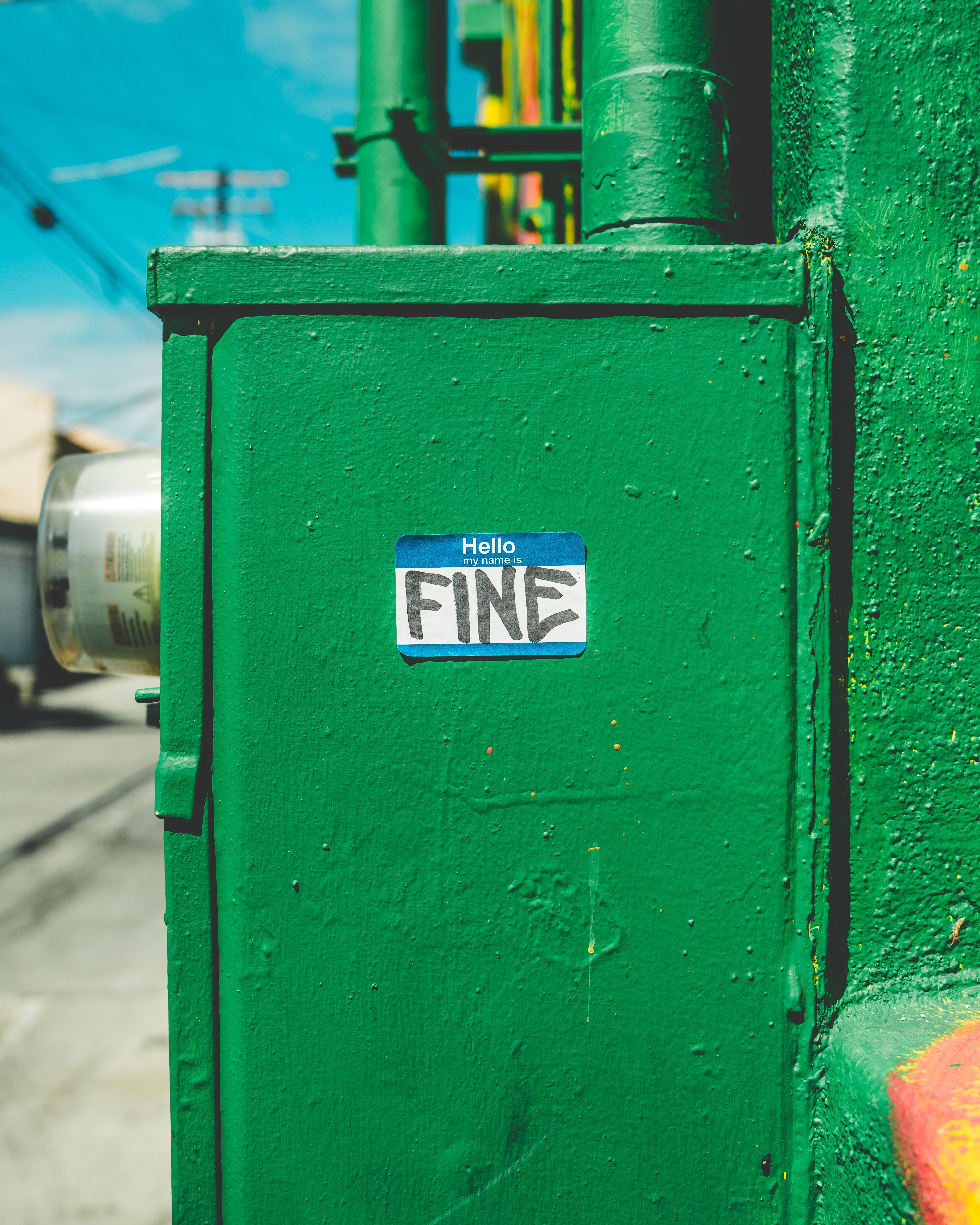 green steel box with fine-printed sticker