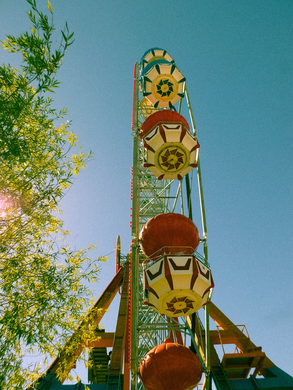 low-angle photography of green ferris wheel