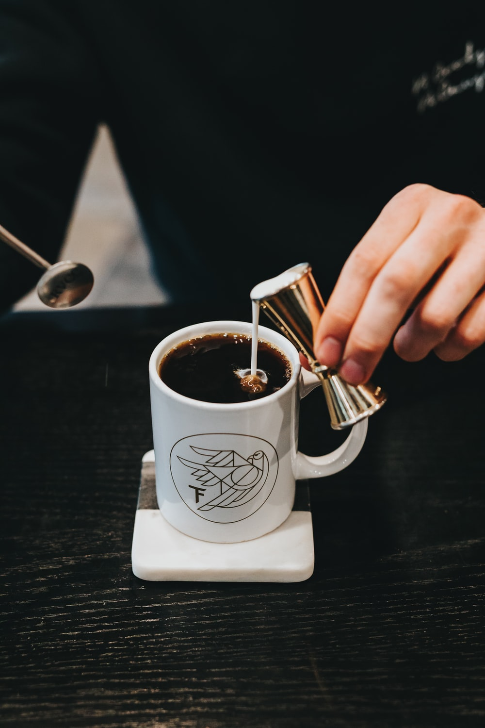 milk pouring on coffee