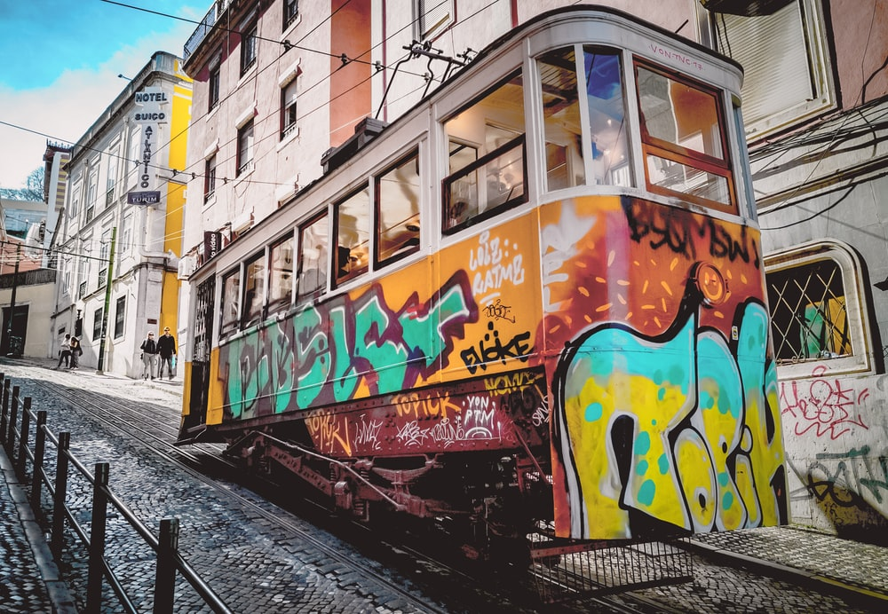 yellow and multicolored tram