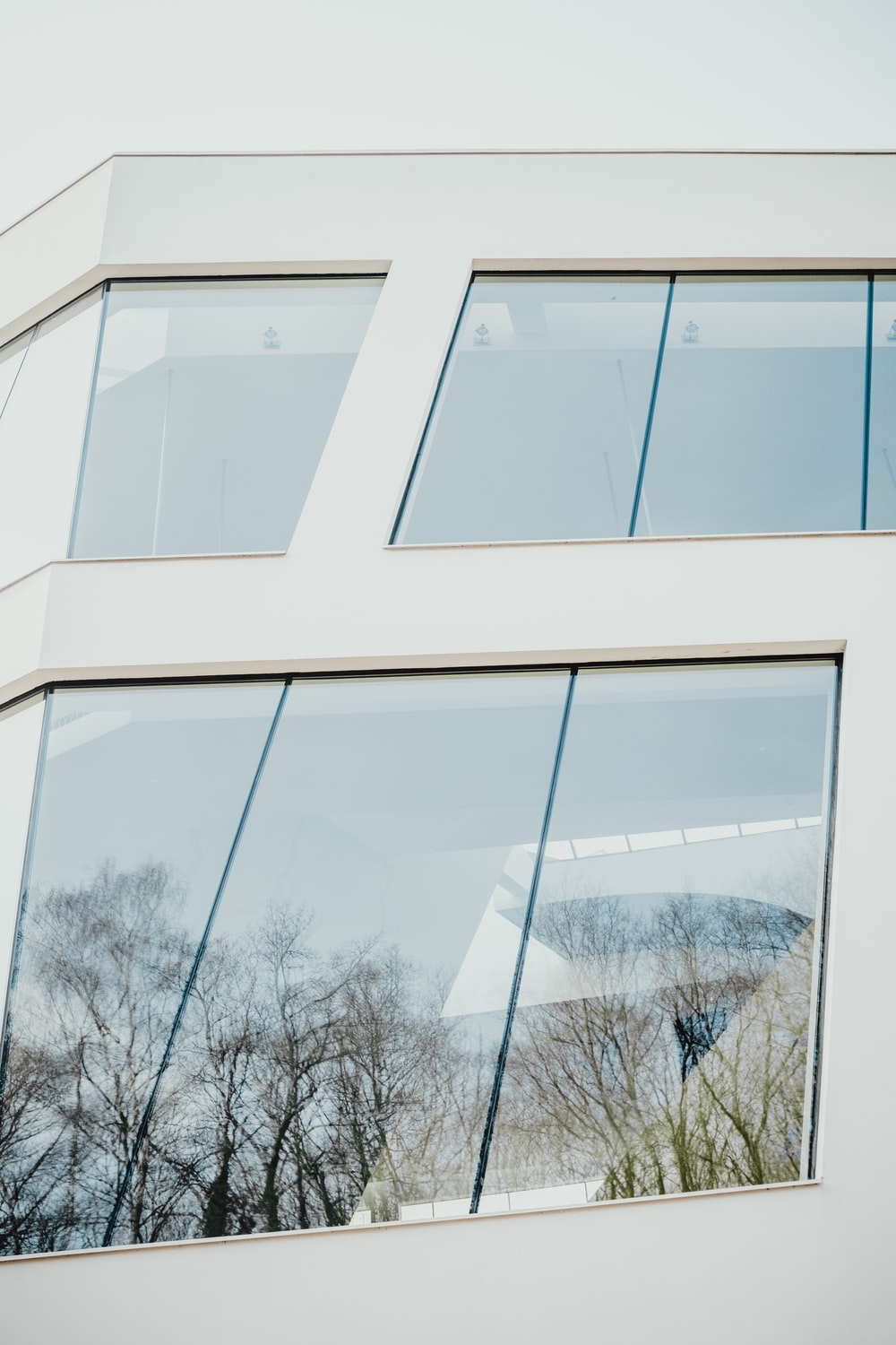 closed clear glass windows of white building