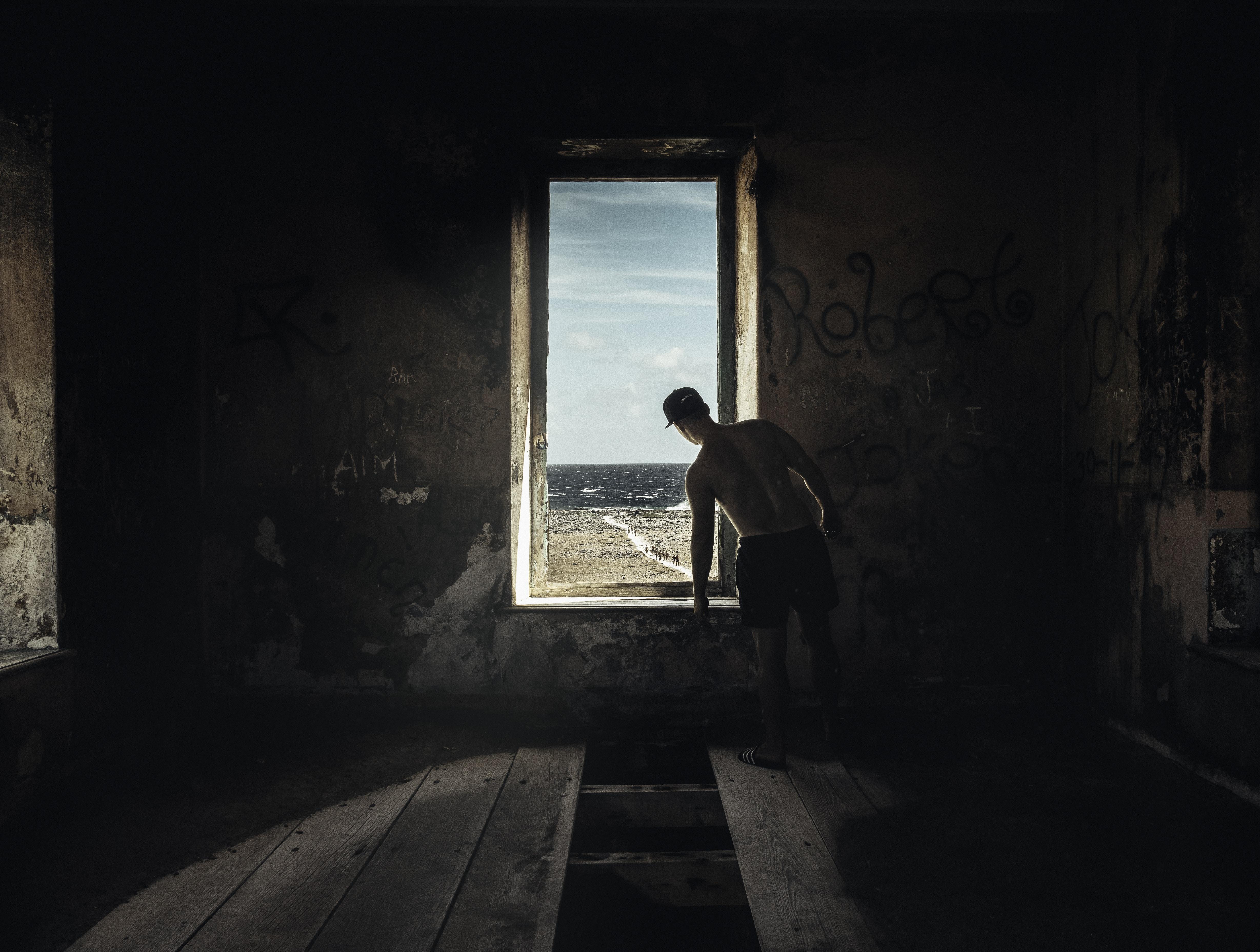 man peeping on window