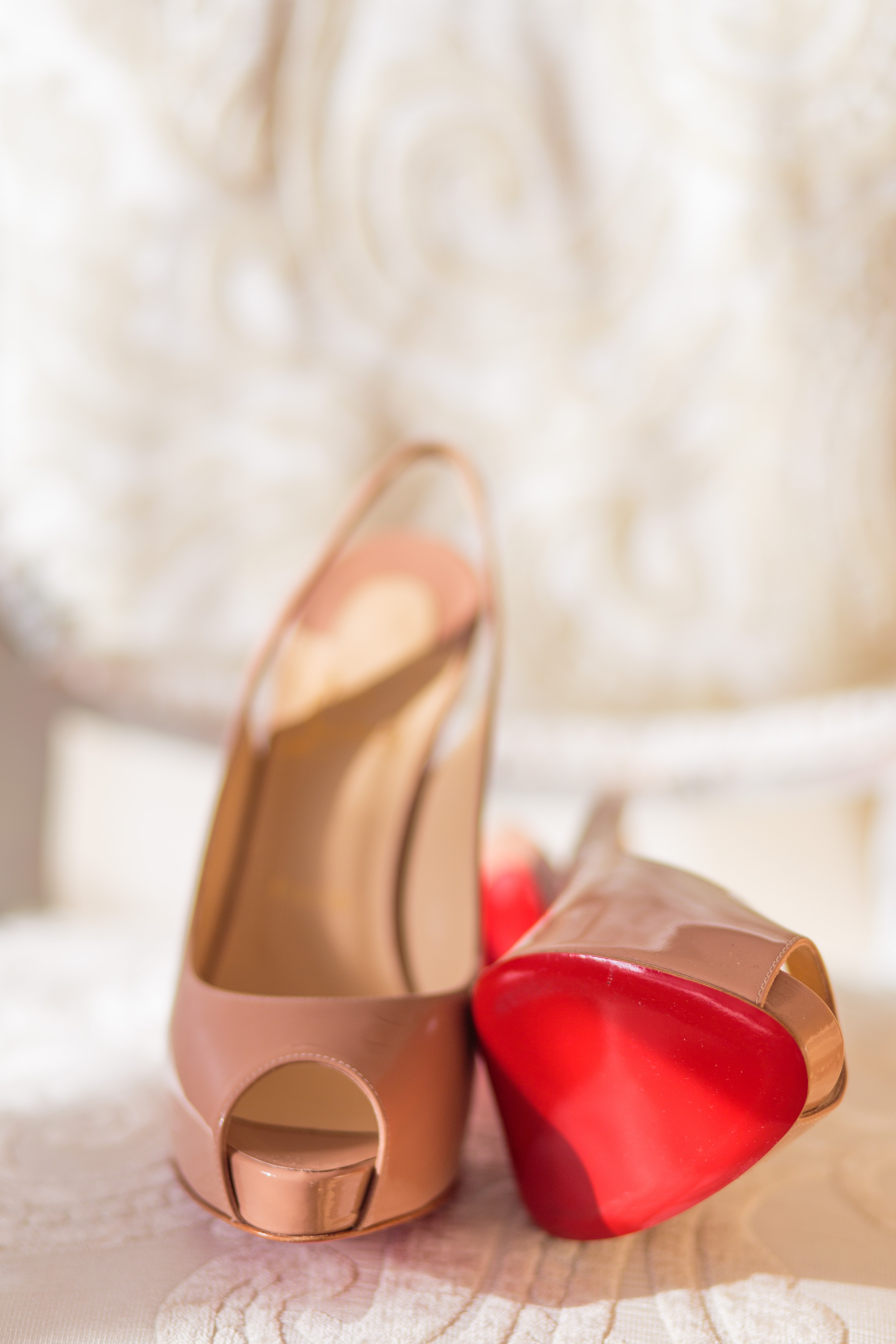 selective focus photography of pair of pink peep-toe heeled sandals