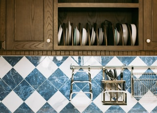organized plate in kitchen cupboard