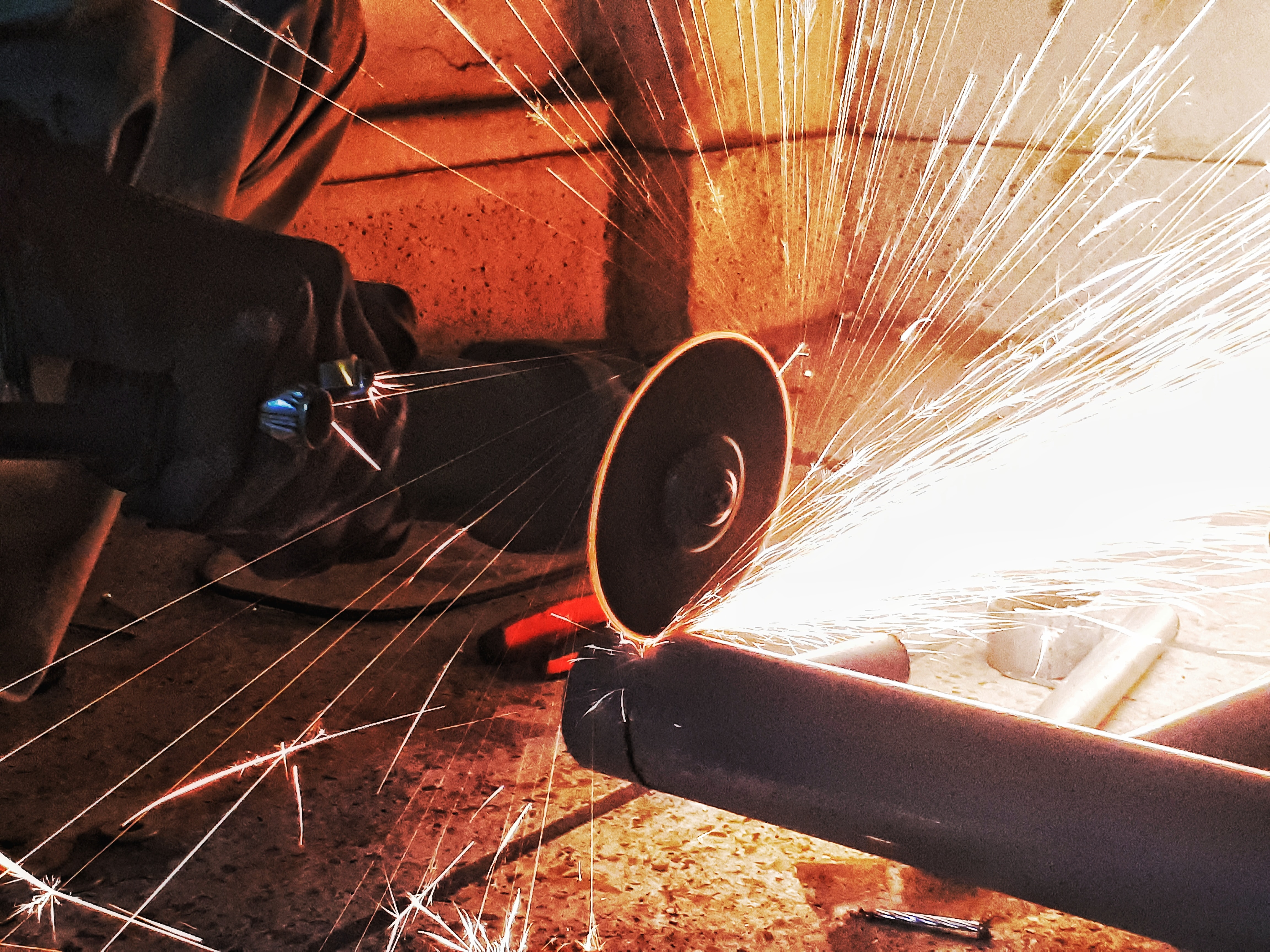 person grinding pipe steel wool photography