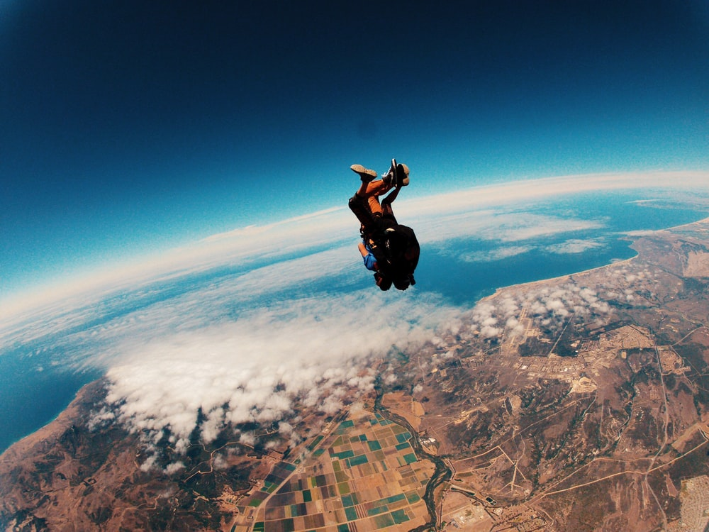 person skydiving on air during daytime