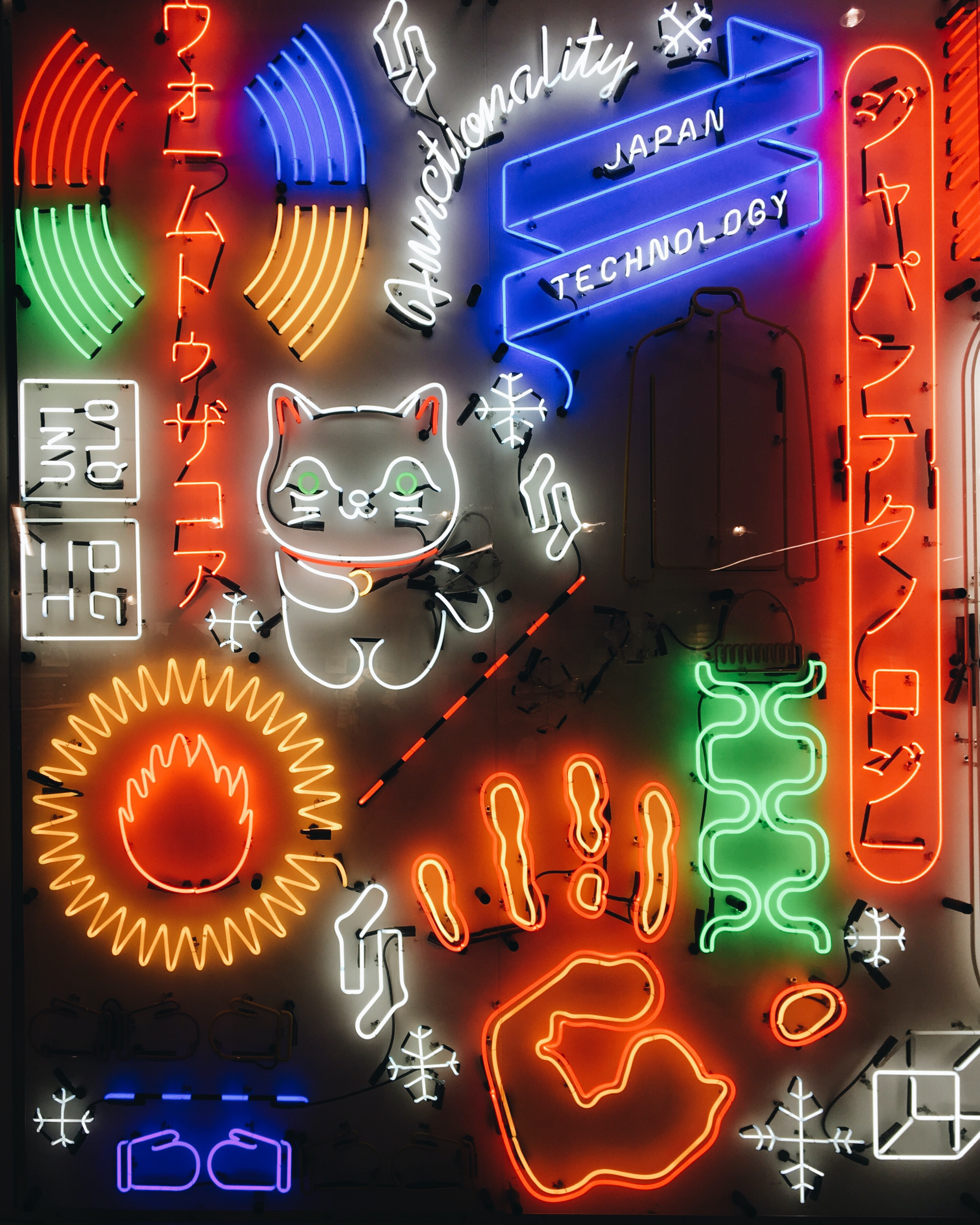 A variety of neon signs all vying for attention