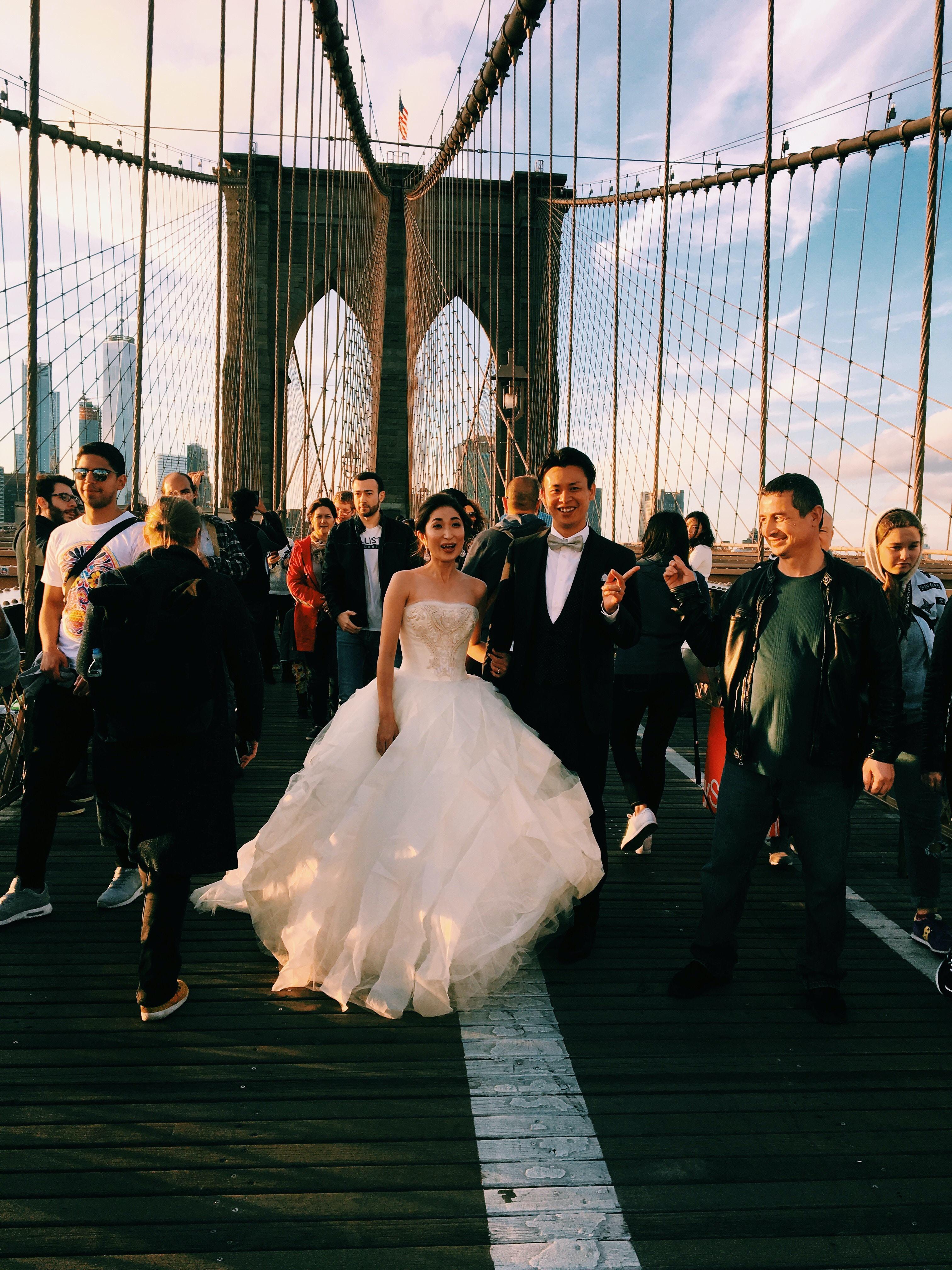 couple standing on suspension bridge