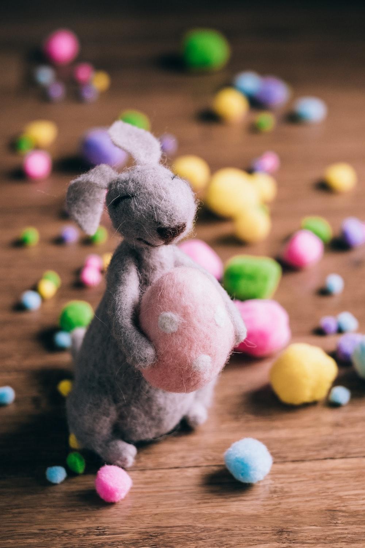 closeup photo of gray rabbit plush toy