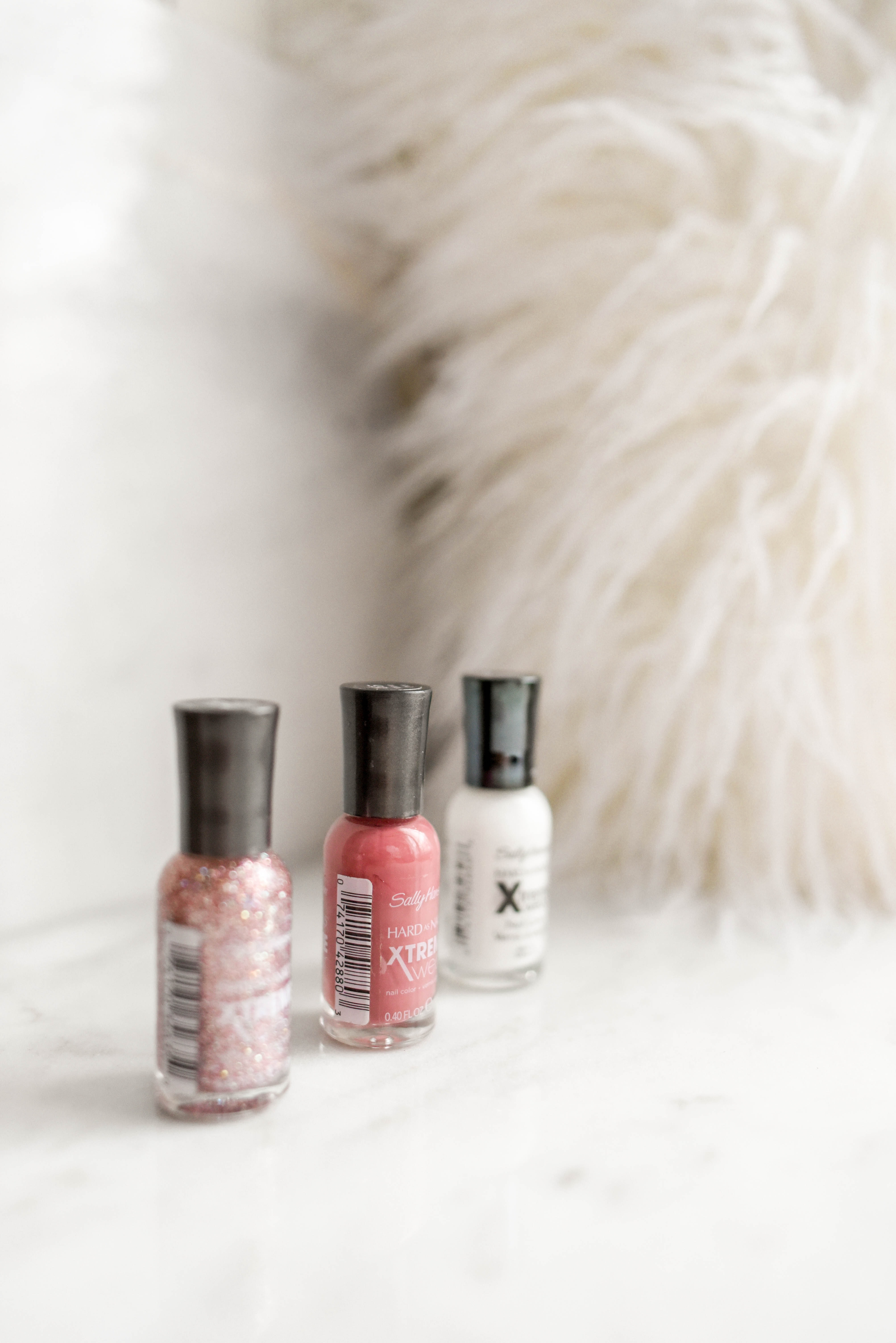 pink, red, and white nail polish bottles