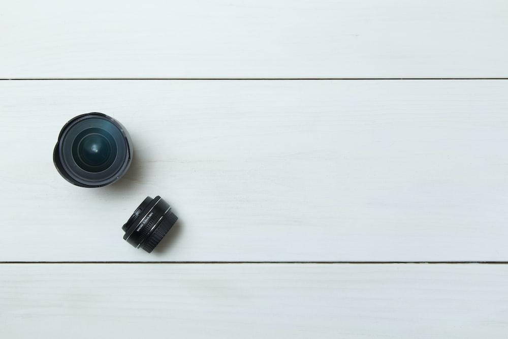 black camera lens on white board