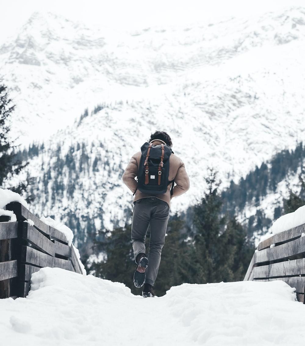 person walking on snowy road