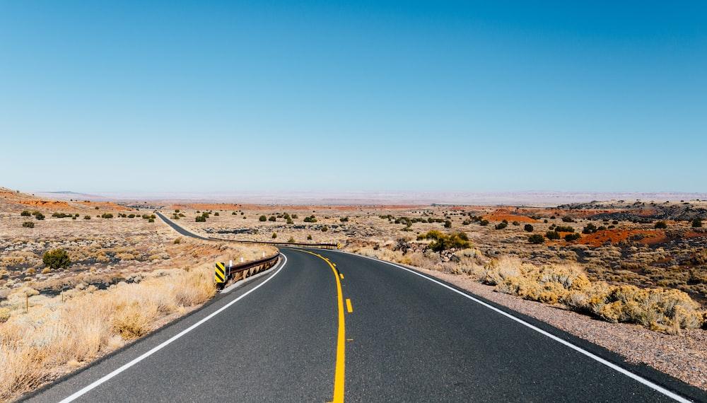 gray asphalt road near desert