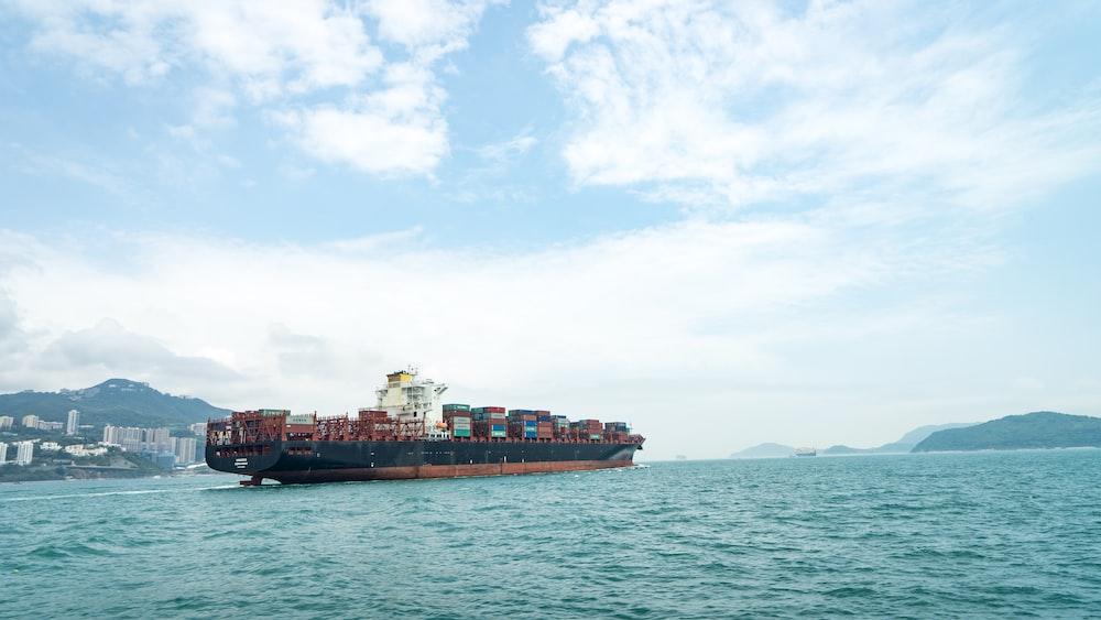 cargo vessel on body of water
