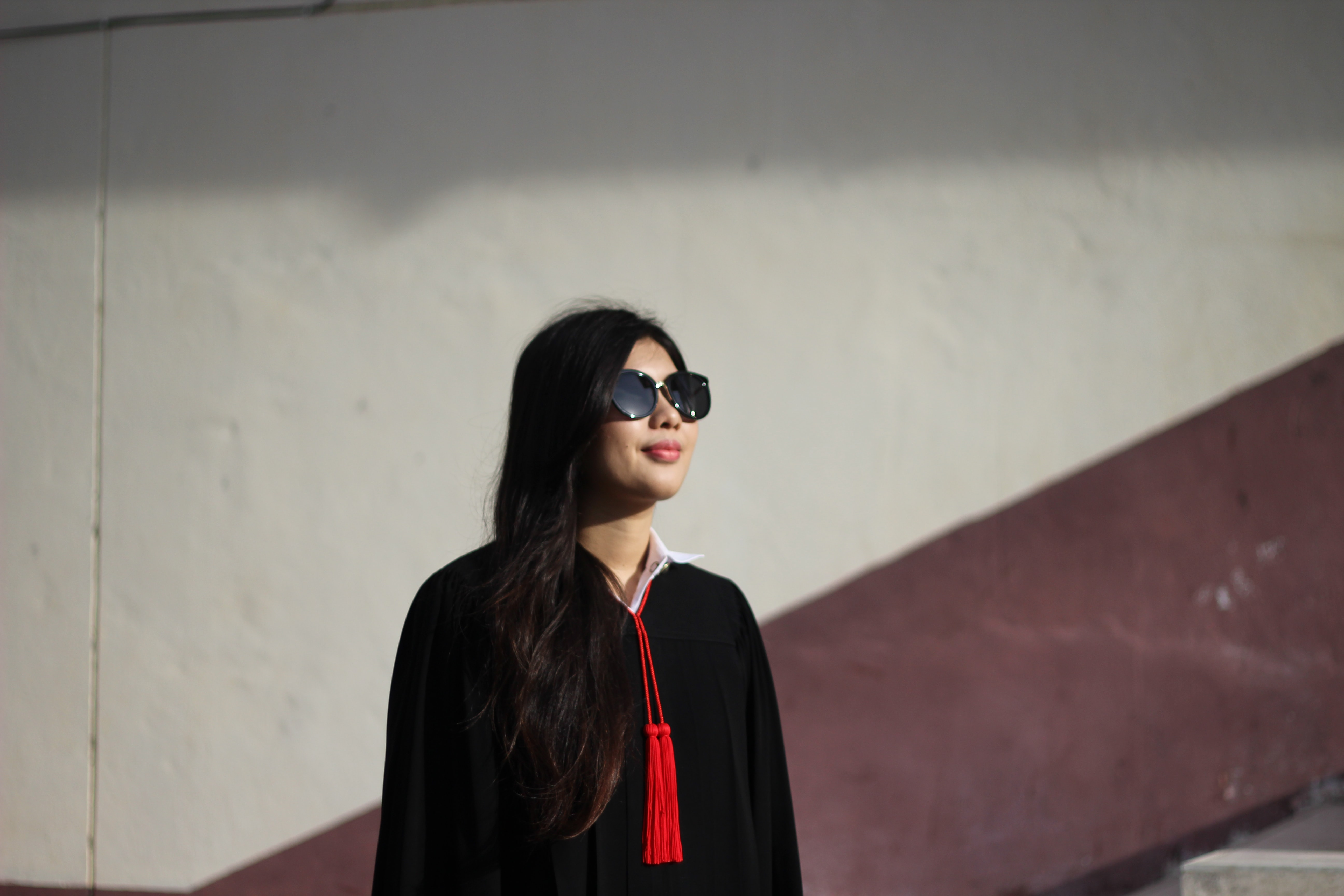 woman wearing black jacket and red top