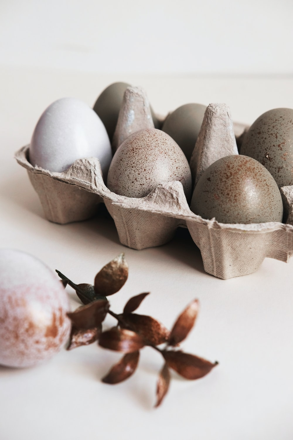 six gray poultry eggs on brown tray