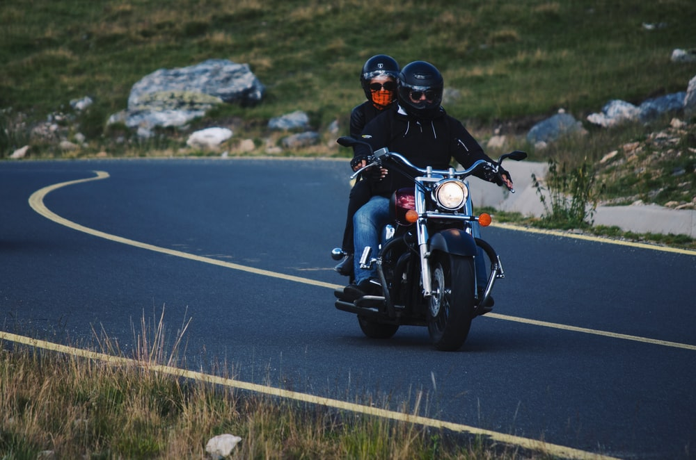 two persons riding motorcyle