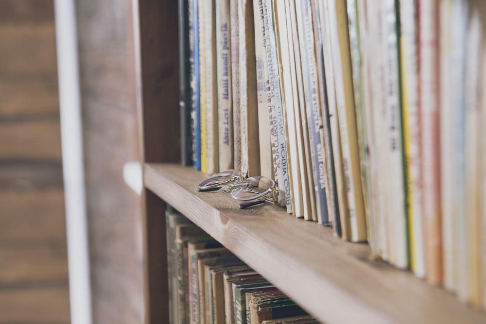 brown wooden book shelf