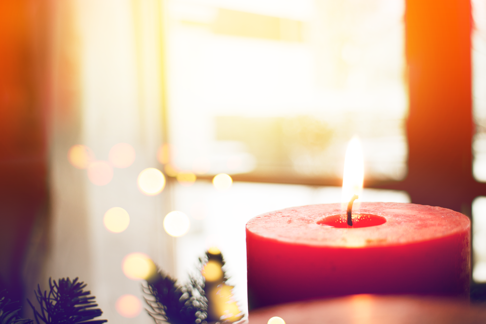 shallow focus photography of red candle